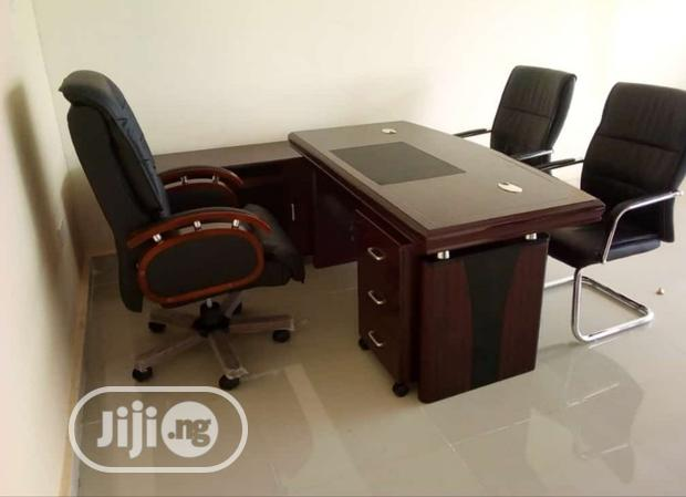 Complete Set of Reliable Executive Office Table and Swivel Chair