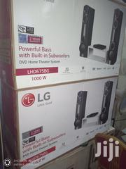 LG 1000W Powerful Bass Built In Subwoofers Full HD Bluetooth DVD Play | Audio & Music Equipment for sale in Lagos State, Ojo