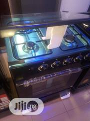 Midea Gas Cooker 4burners With Oven And Grill Automatic Blue Flame | Kitchen Appliances for sale in Lagos State, Ojo