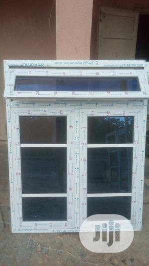 White Window With Blue Reflective Glass