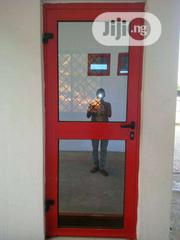 Indoor Red Colour With Standard Glass   Doors for sale in Lagos State, Agege
