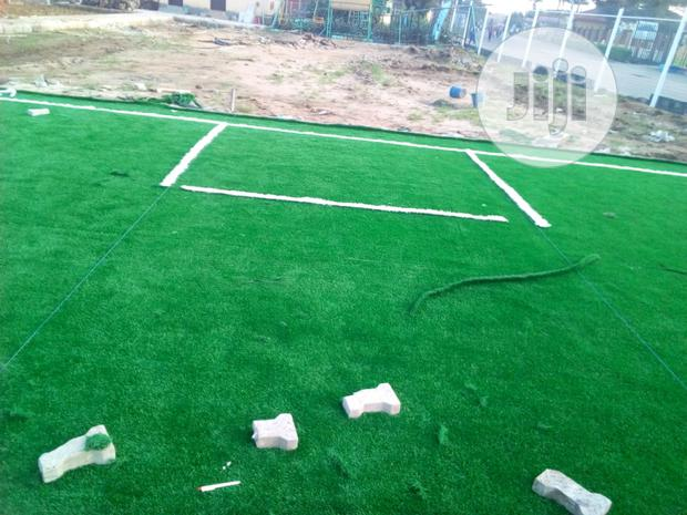 Installation Of Turf Green Grass On School Playing Ground
