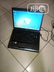 Laptop Toshiba Satellite L300D 2GB AMD HDD 250GB   Laptops & Computers for sale in Lagos State, Ilupeju